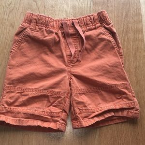 Used in great condition boys orange shorts. Size 2